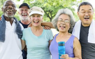 Group of senior friends exercising in park together